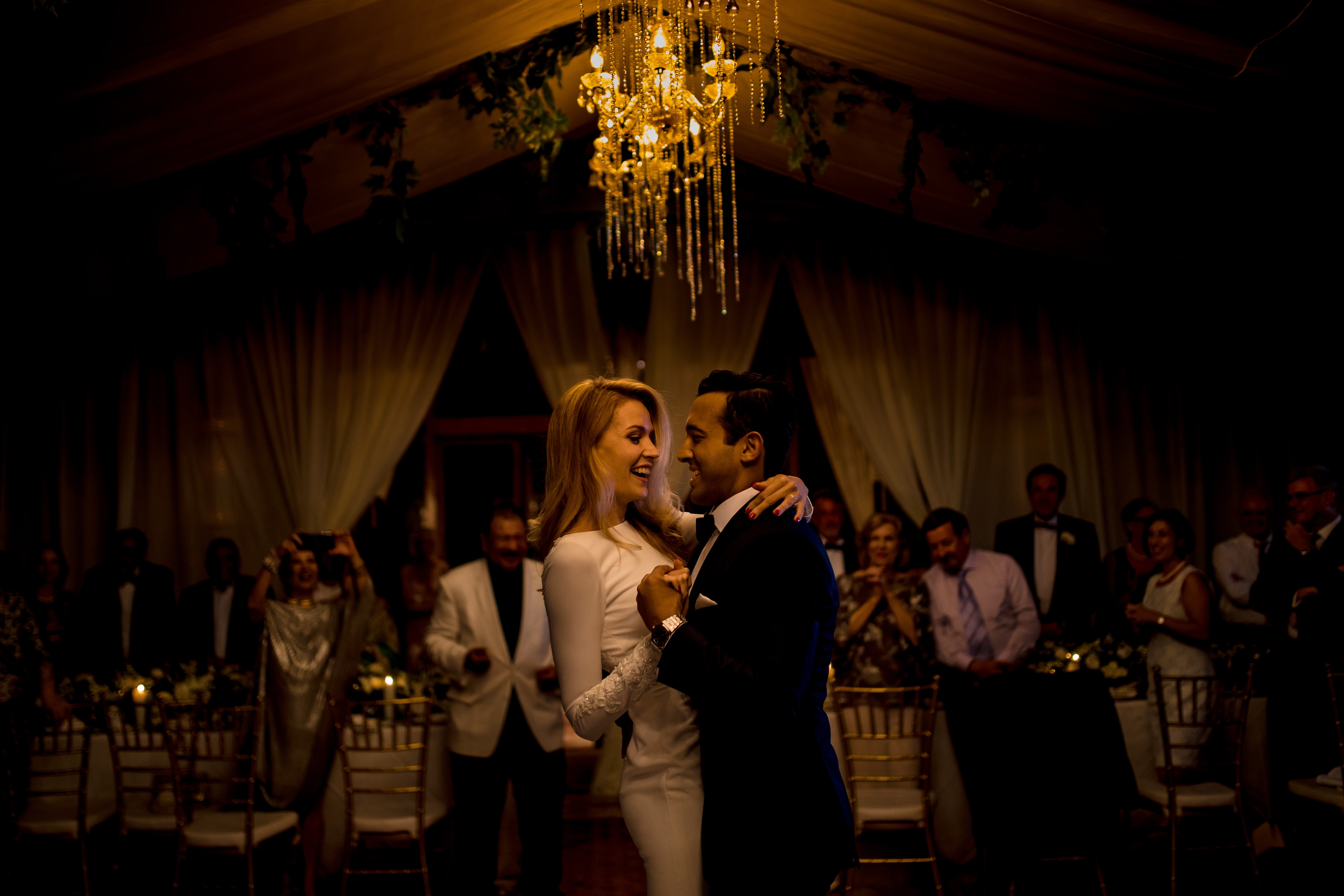 A bride and groom share a first dance by Shangri-La wedding photographer Julian Abram Wainwright
