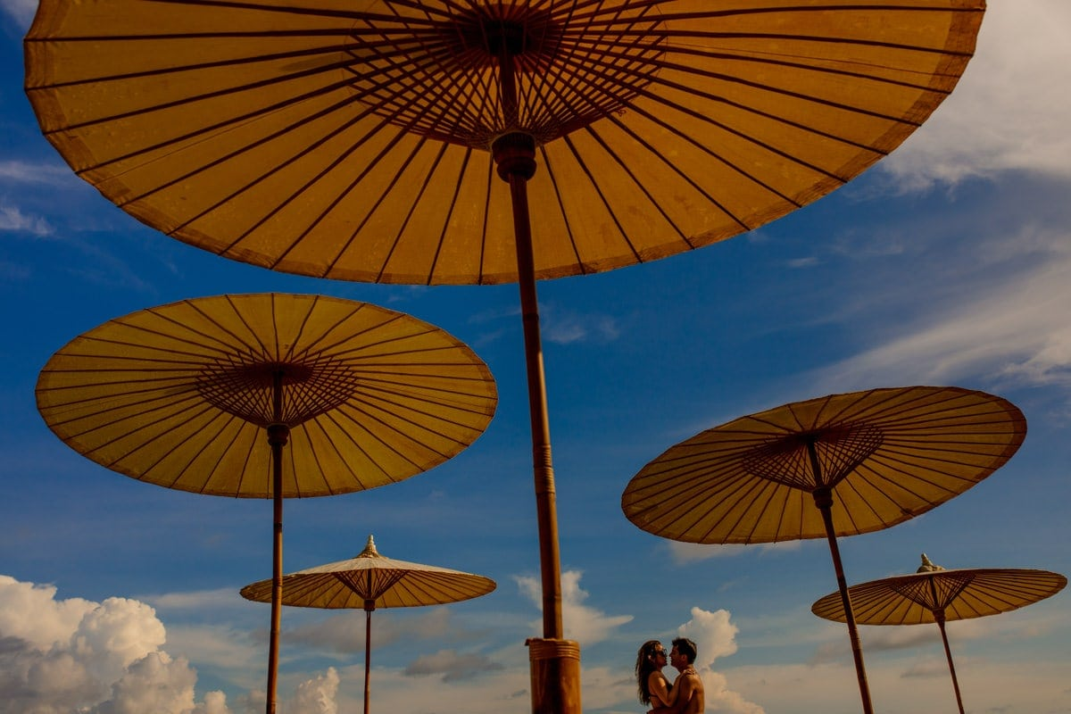 Destination wedding with umbrellas in Phuket, Thailand by Julian Abram Wainwright