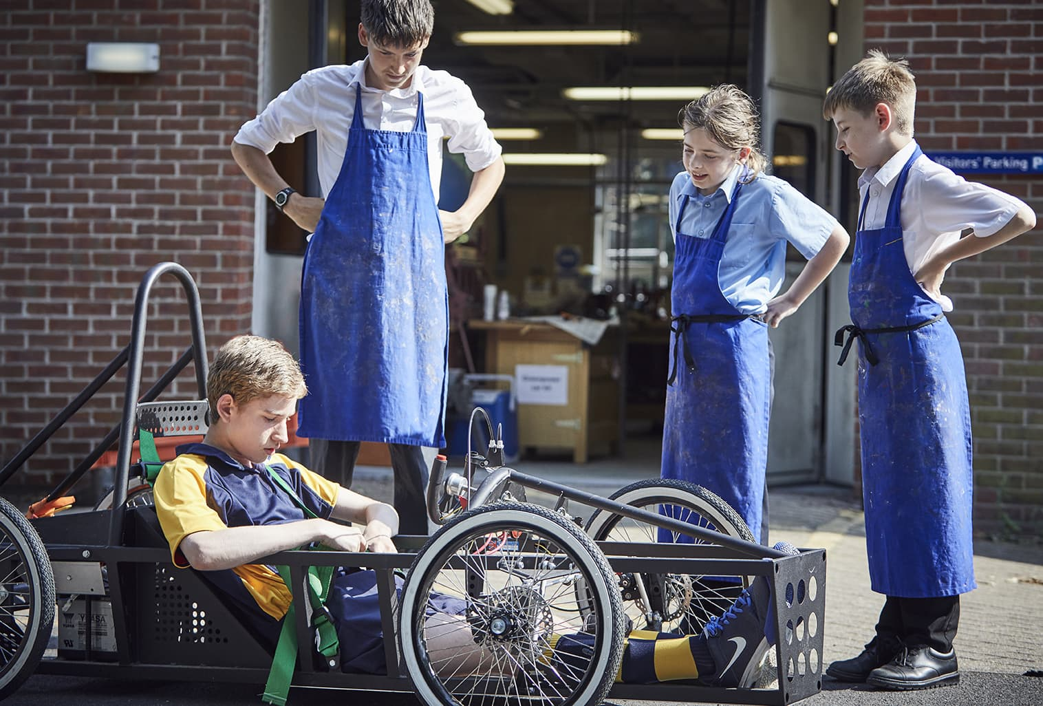 Students checking the kart they created