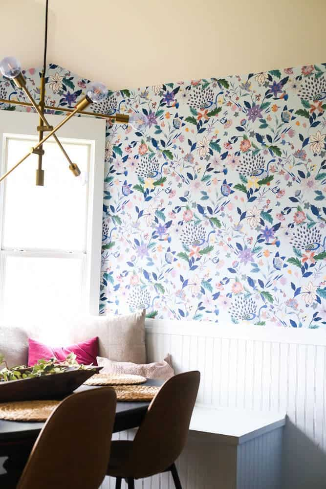 small dining room with floral wallpaper