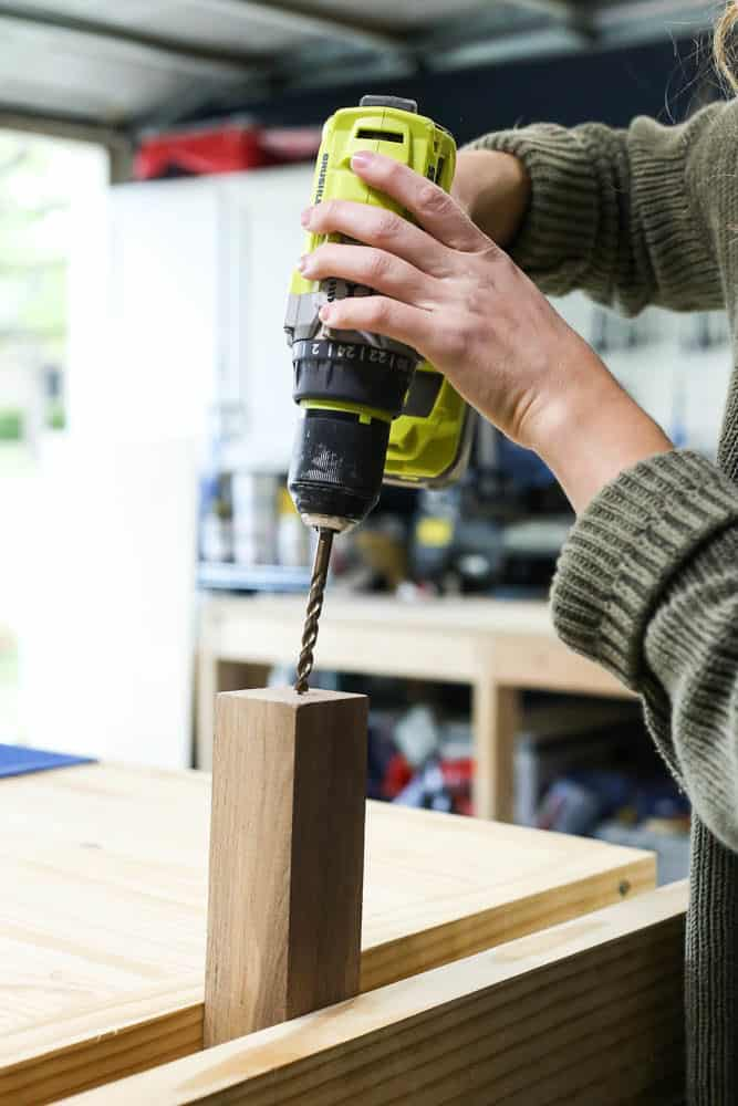 woman using a vice to drill