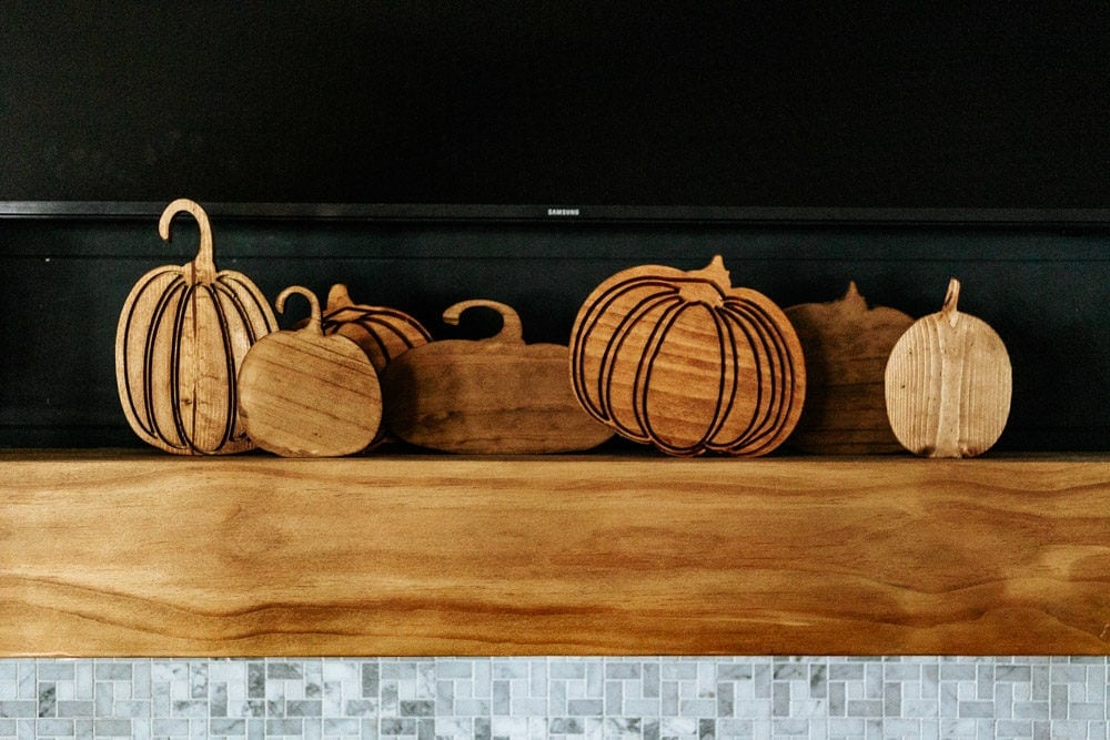 collection of wooden carved pumpkins