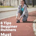 female runner on track tying shoe