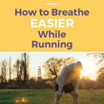 male runner breathing hard on a morning run, resting with hands on knees