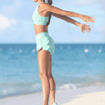 female runner jumping on beach
