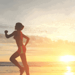 female runners legs in the hot weather and at sunrise