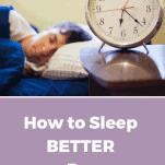 man sleeping on bed near alarm clock