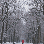 female runner in cold snow winter