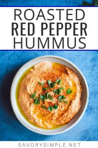 Learn how to make this smokey roasted red pepper hummus recipe at home! You won't believe how easy it is, and it tastes worlds better than pre-packaged hummus.