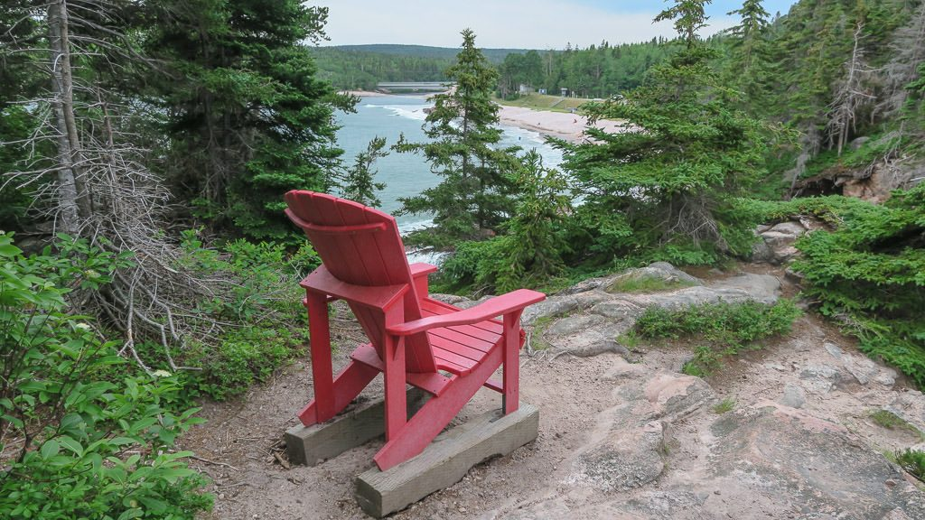 Red Chair overlooking a gorgeous view found on a small hike in cape breton highlands in Nova Scotia