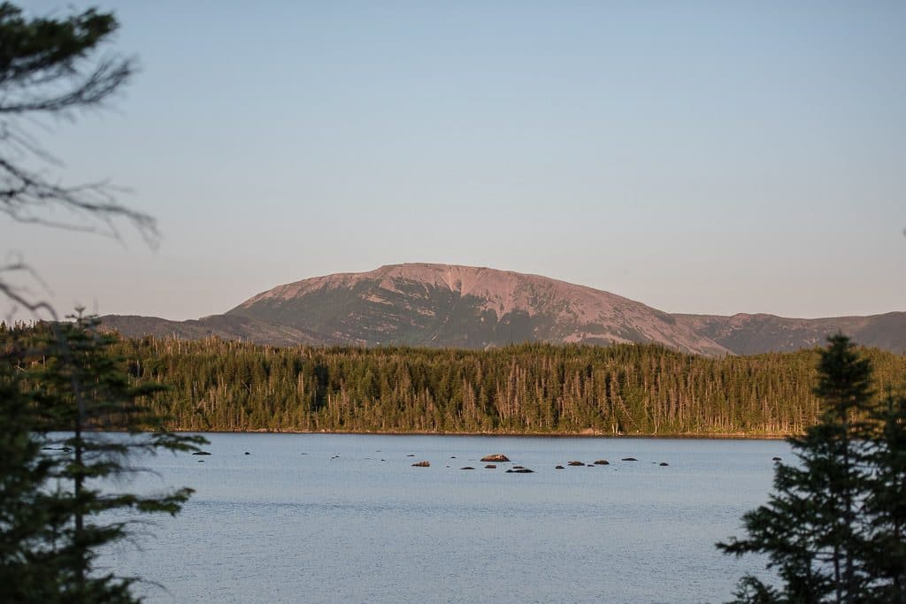 View of Gros Morne Mountain in Newfoundland from a lake in the distance