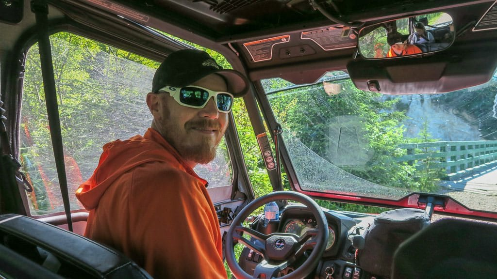 Buddy behind the driver's seat of the ATV on our Newfoundland ATV Tour