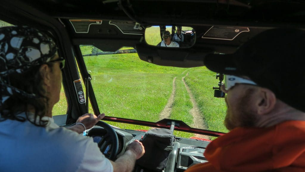 Paul driving the ATV with Buddy in the passenger seat during our Newfoundland ATV Tour