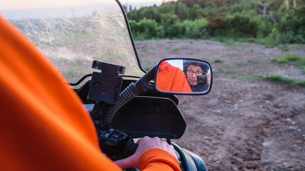 Brooke taking a photo in the side mirror during our ATV tour