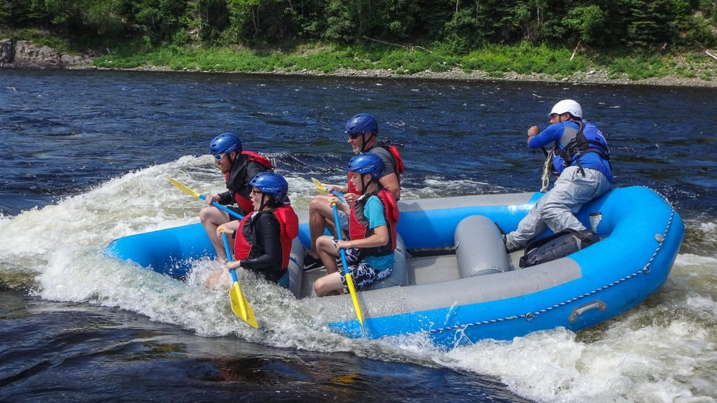 Riding the waves on the Exploits River during our whitewater rafting trip in Newfoundland