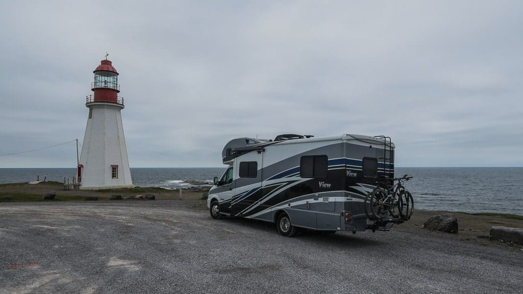 RV next to a lighthouse in Newfoundland where we boondocked for a night