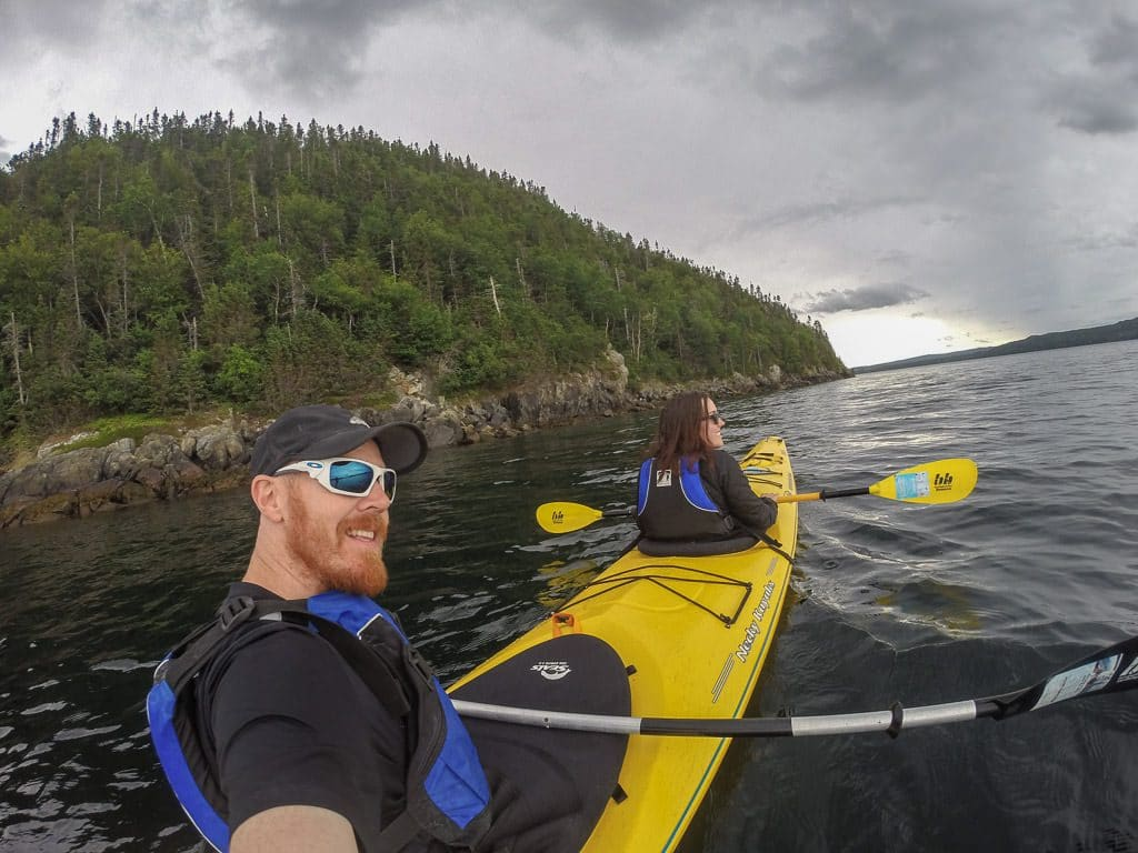 Brooke and Buddy in a kayak out on the water while Exploring Terra Nova National Park