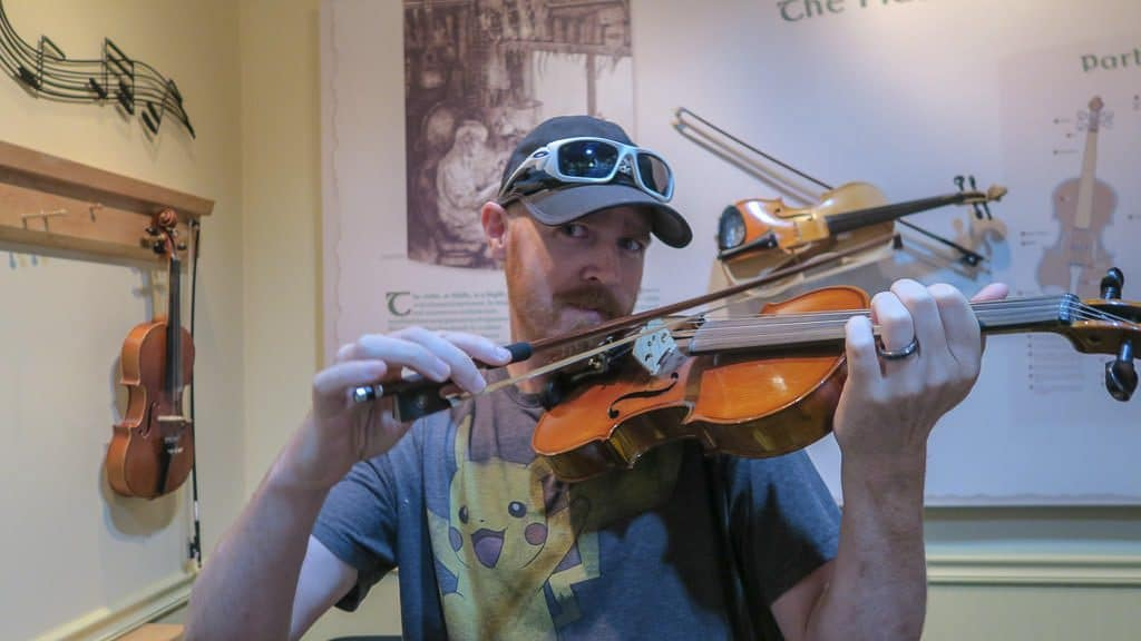 Buddy playing a fiddle while at the Celtic Music Interpretive Centre