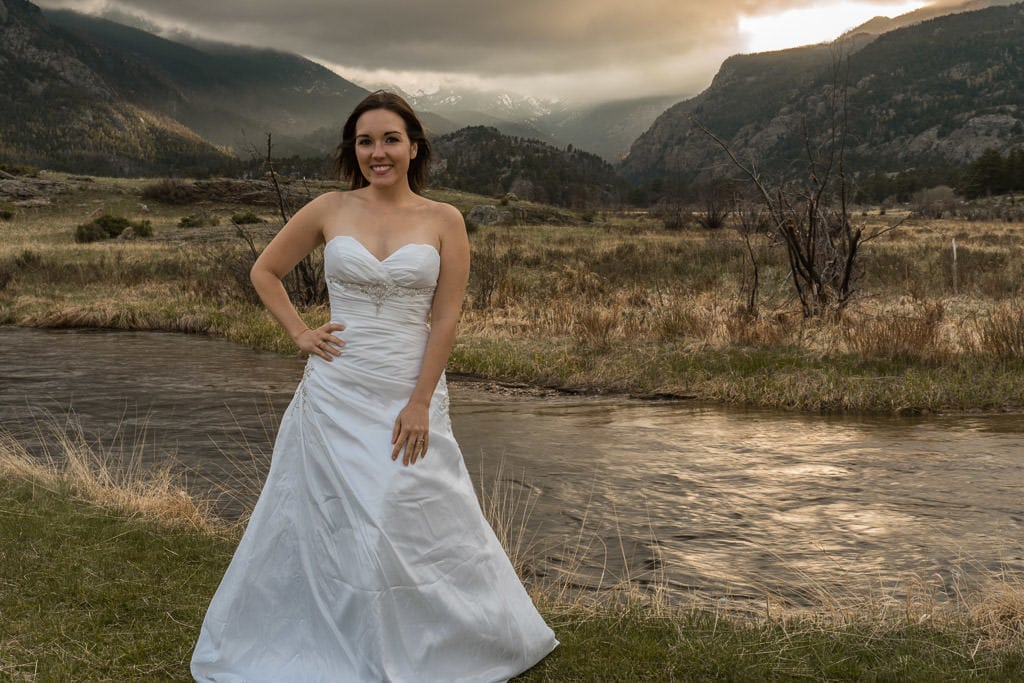 bride photo for rocky mountain vow renewal with sunset through mountains
