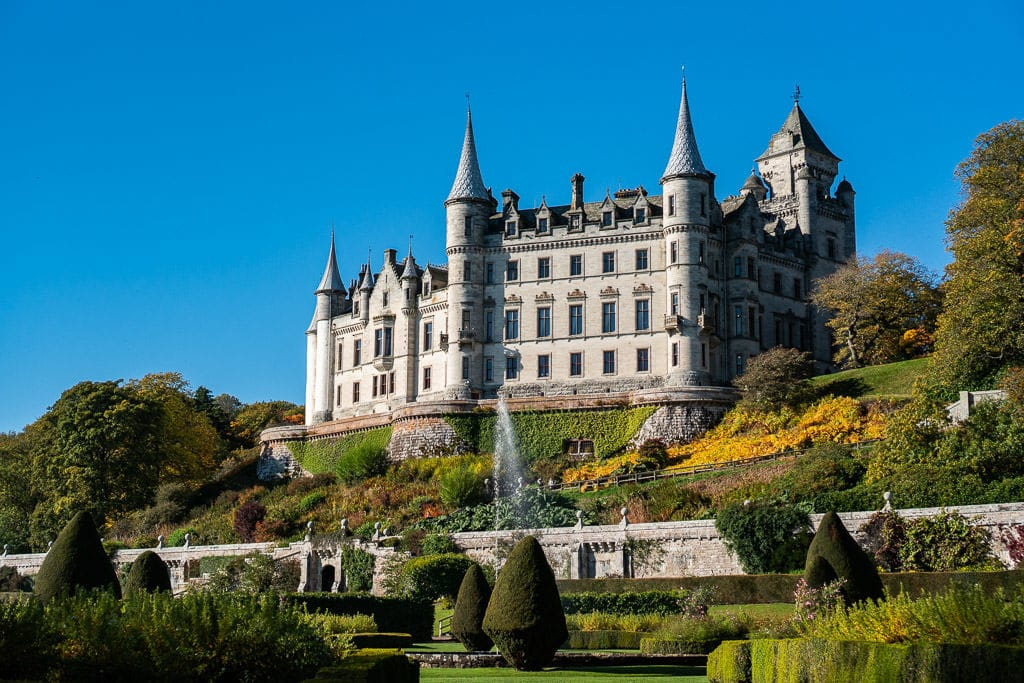 The beautiful French-inspired Dunrobin Castle from the garden set behind the castle entrance. This is a perfect day trip from Inverness Scotland