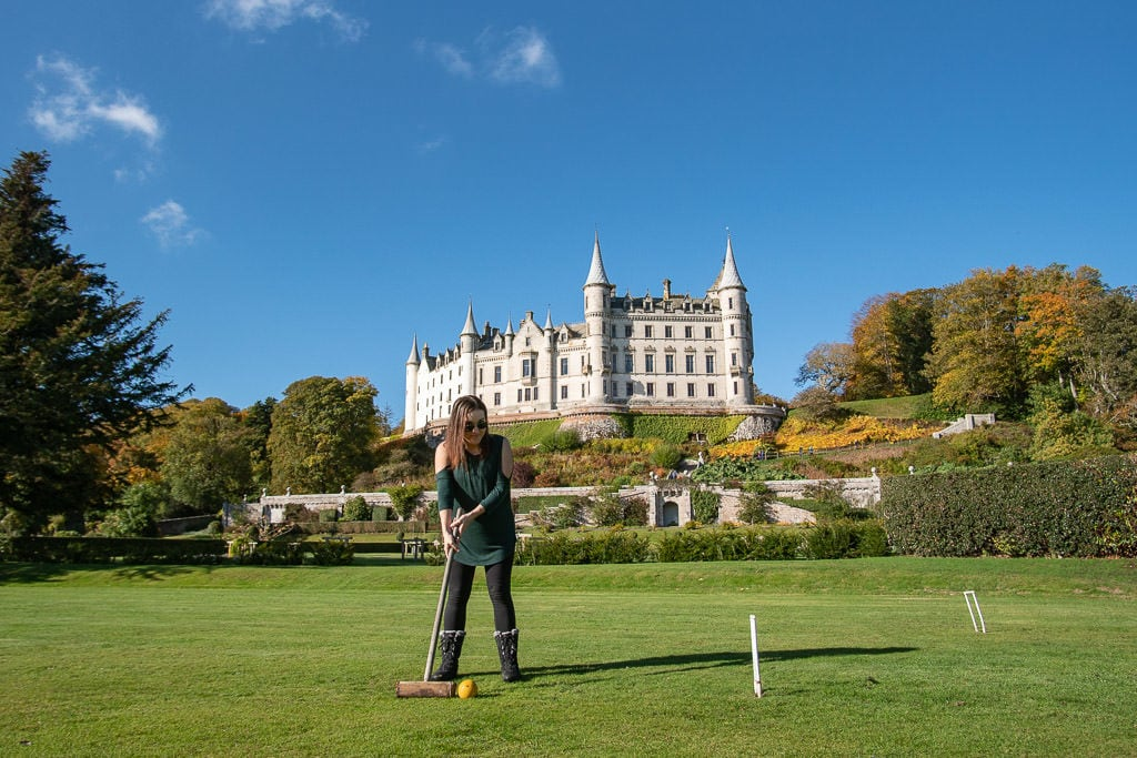 Brooke playing some croquet in the garden with the beautiful Dunrobin Castle behind her