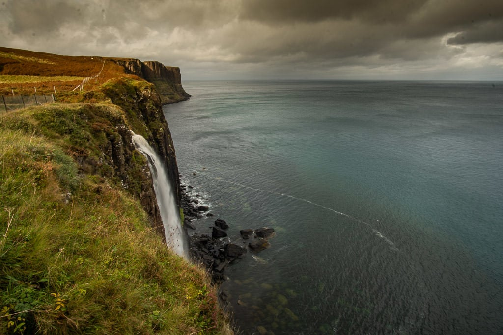 The gorgeous Mealt Falls going over the cliff in the Isle of Skye on a cloudy and gloomy day
