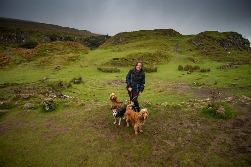 Brooke with 3 dogs at Fairy Glen in the Isle of Skye