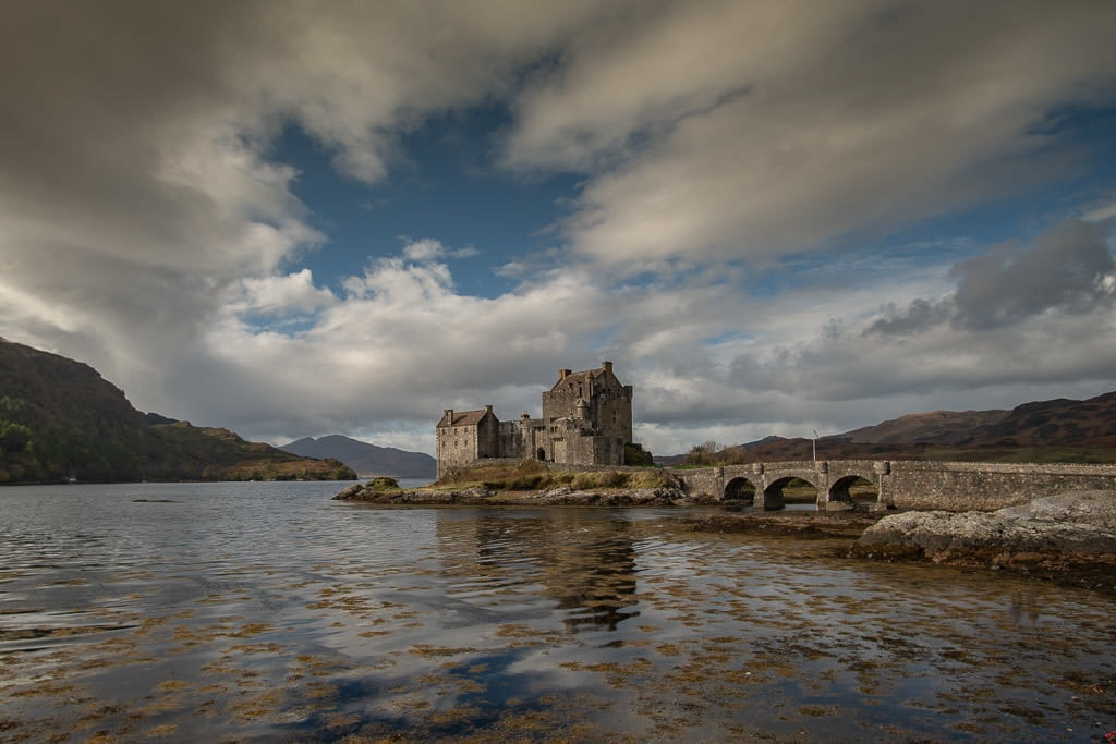 Outside view of Eilean Donan Castle from a distance near the Isle of Skye