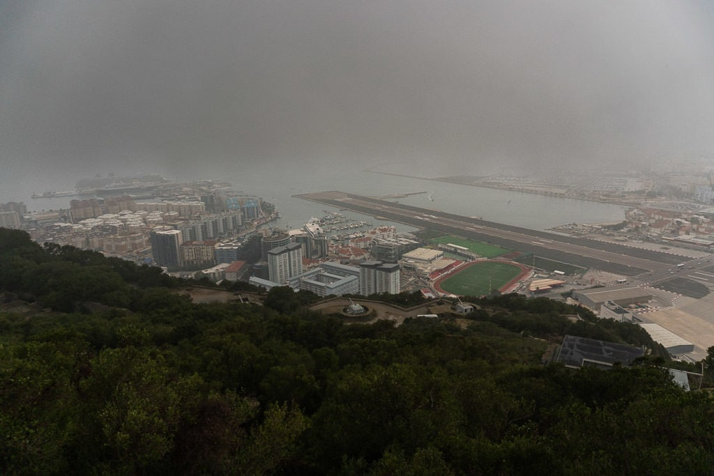 landing strip on foggy day of gibraltar