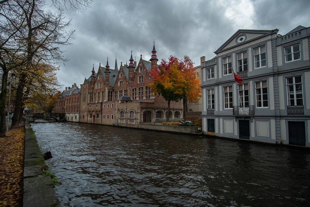 canal with autumn tree colors in bruges belgium