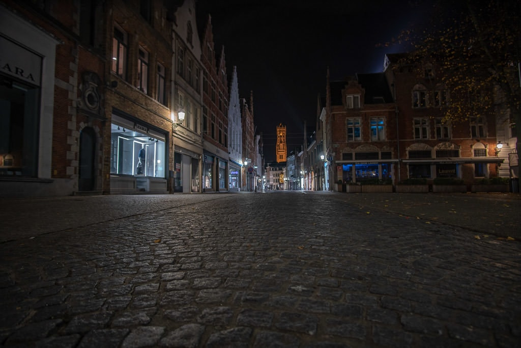 sidewalk and city at night during a perfect weekend in bruges belgium