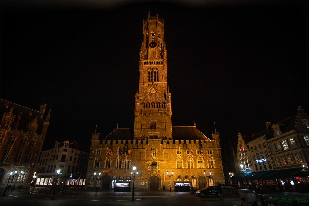 famous in bruges clock tower at night in bruges belgium