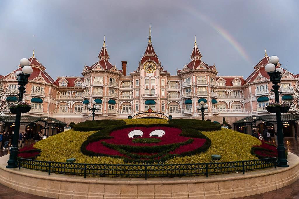 entry to Disneyland Paris near france with rainbow overhead