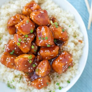 Sweet and spicy Firecracker Chicken served over cauliflower rice.
