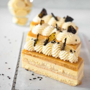 Passionfruit and White chocolate mousse cake with black sesame praline