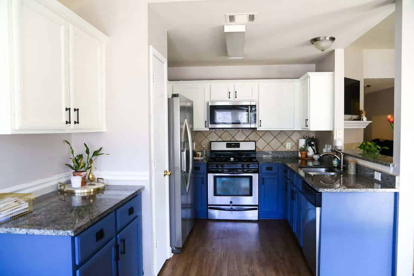Painting blue and white kitchen cabinets & Our DIY Blue u0026 White Kitchen Cabinets - Love u0026 Renovations