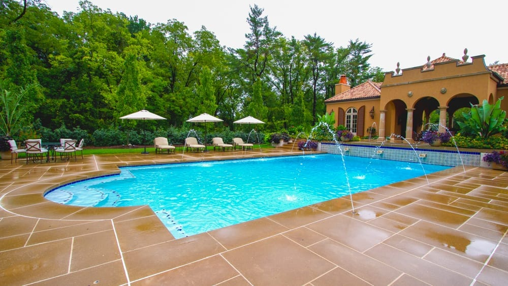 Installed Stone Pool Decking by The Pool Specialists