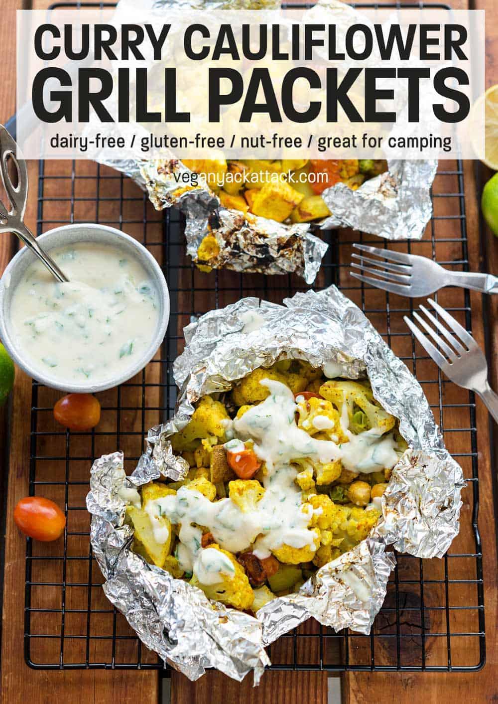 Grill packet filled with curry cauliflower veggie mixture topped with yogurt sauce
