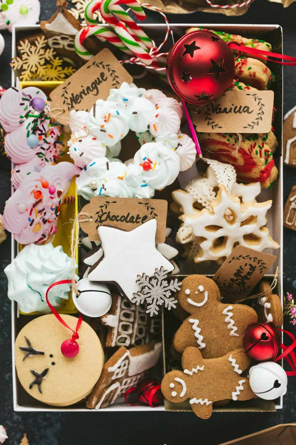 A gift box filled with homemade Christmas cookies and biscuits.