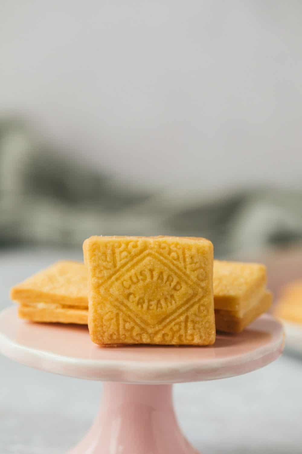 A Custard Cream biscuit on its side.