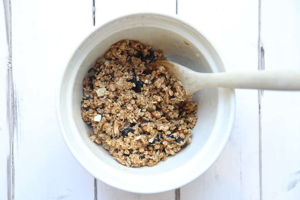 A bowl containing mixture for granola bars