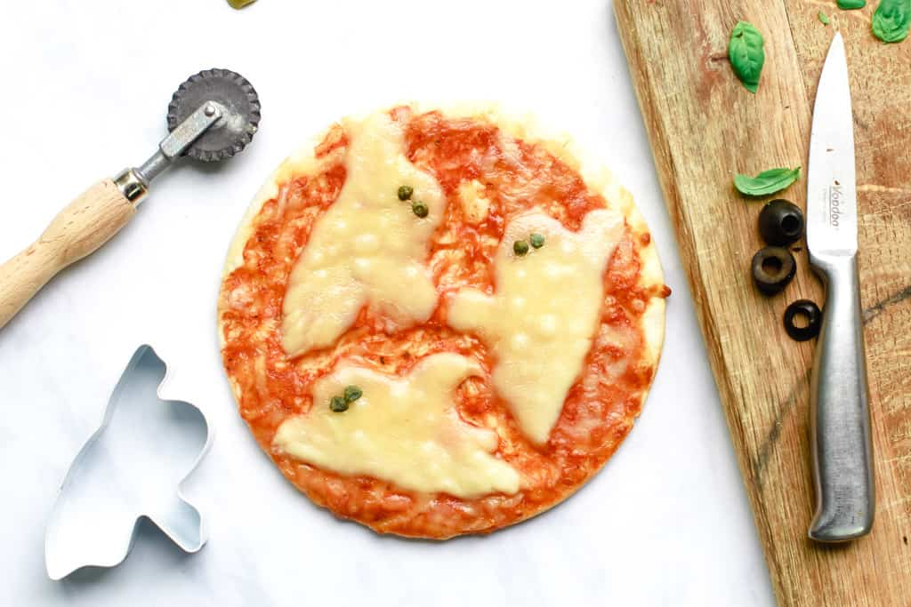 Overhead shot of a Halloween Pizza with cheese ghosts