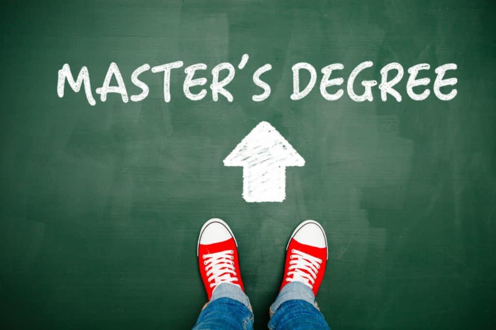 Master's Degree written on chalkboard with arrow pointing upward