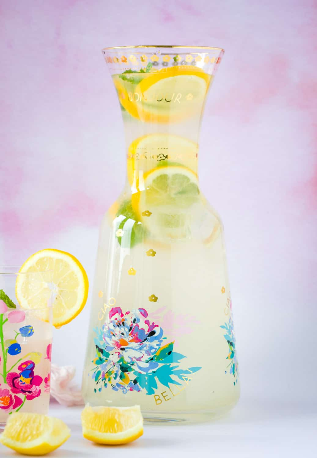 A pitcher of lemon cordial with slices of lemon and sprigs of mint