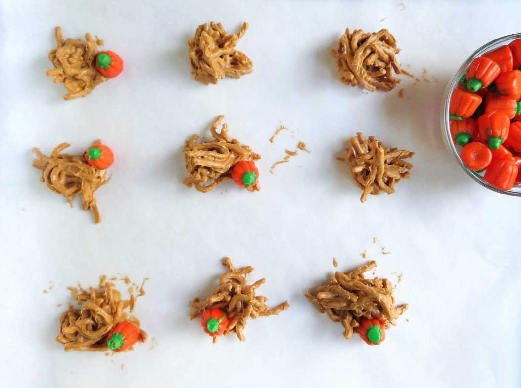 These adorable fall peanut butter haystacks are the perfect centerpiece for your Autumn or Halloween gathering, and the kids will love helping you make them.
