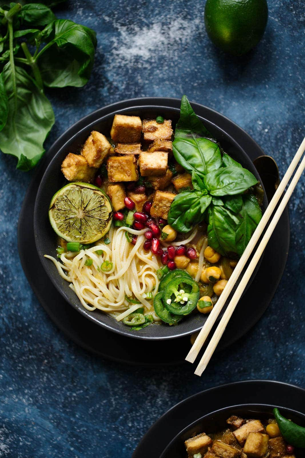 A Thai Coconut Curry Soup with crispy tofu, rice noodles, and tons of fresh basil.
