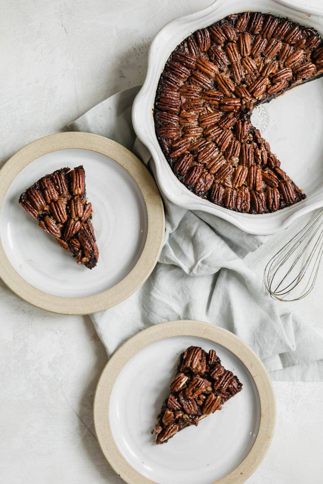 A Brownie Pecan Pie to end all other pecan pies. Fudgy, rich, sweet, nutty, and chocolatey. Calling this a crowd-pleaser is an understatement.