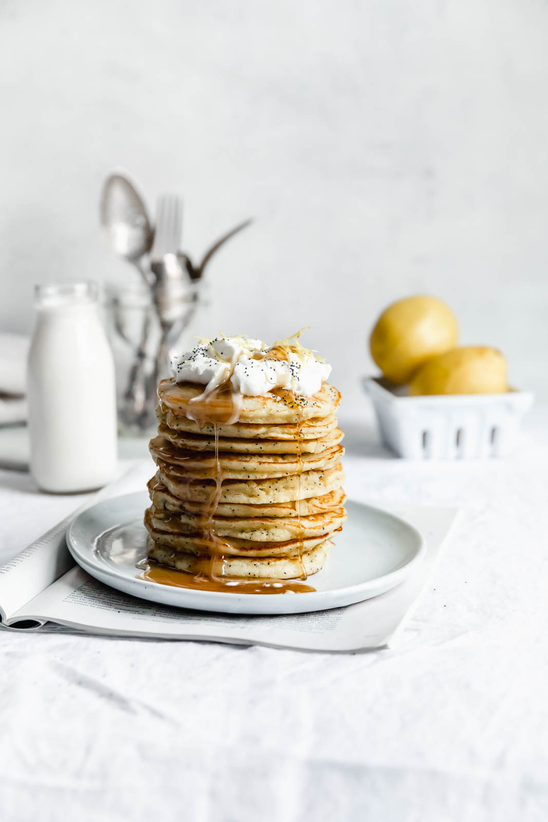 Light and fluffy Gluten Free Lemon Poppy Seed Pancakes made with almond flour and lemon zest. But proceed with caution: you might eat the whole batch!