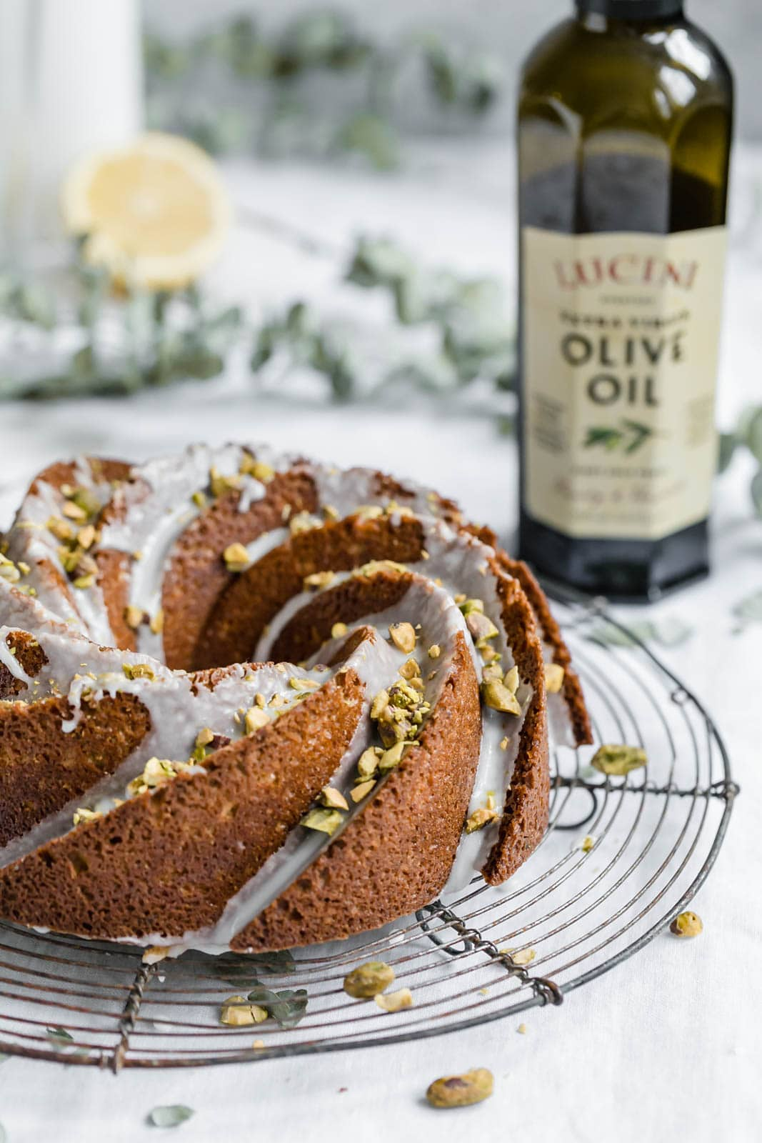 pistachio olive oil cake with lemon icing