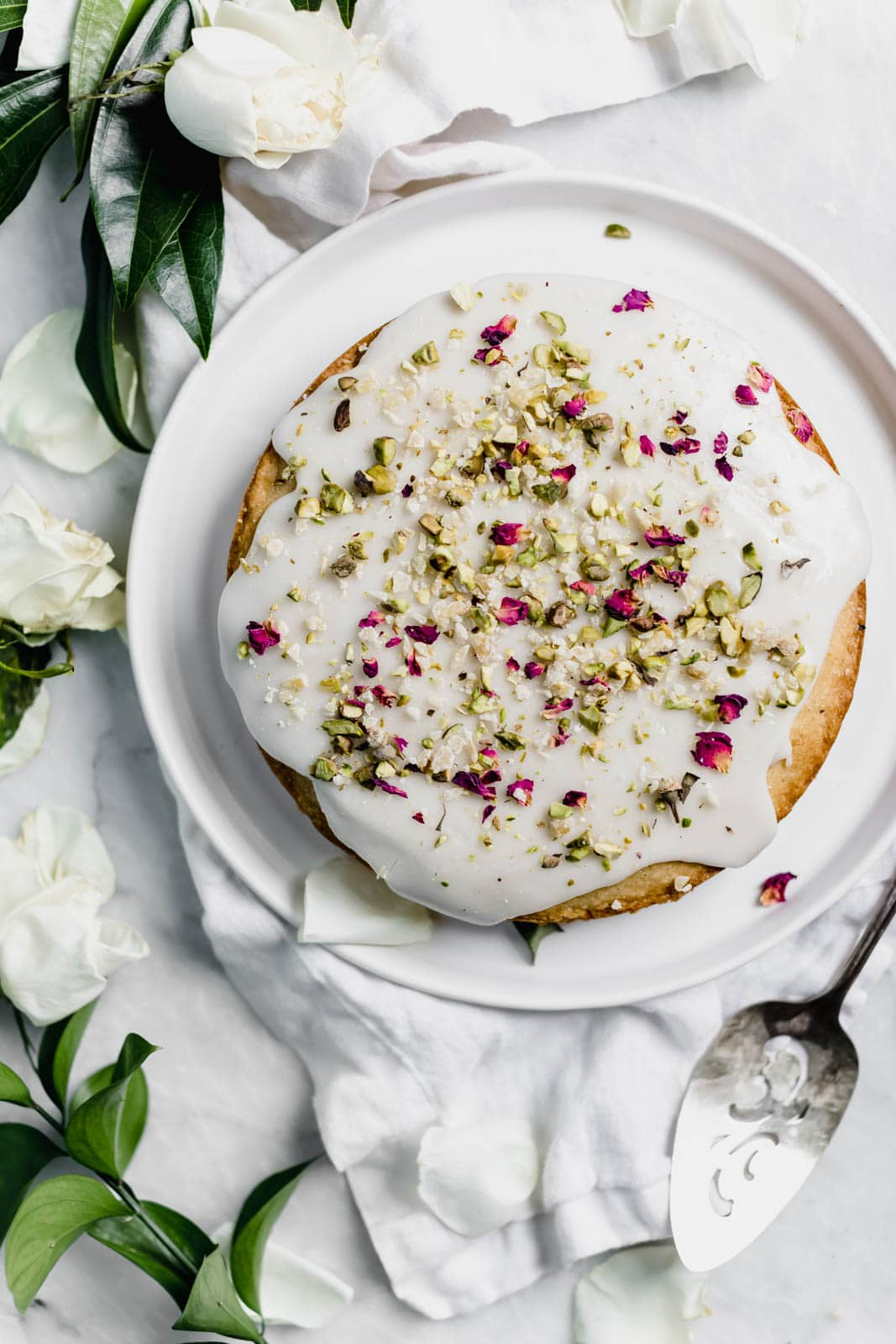 almond and rose cake on a plate